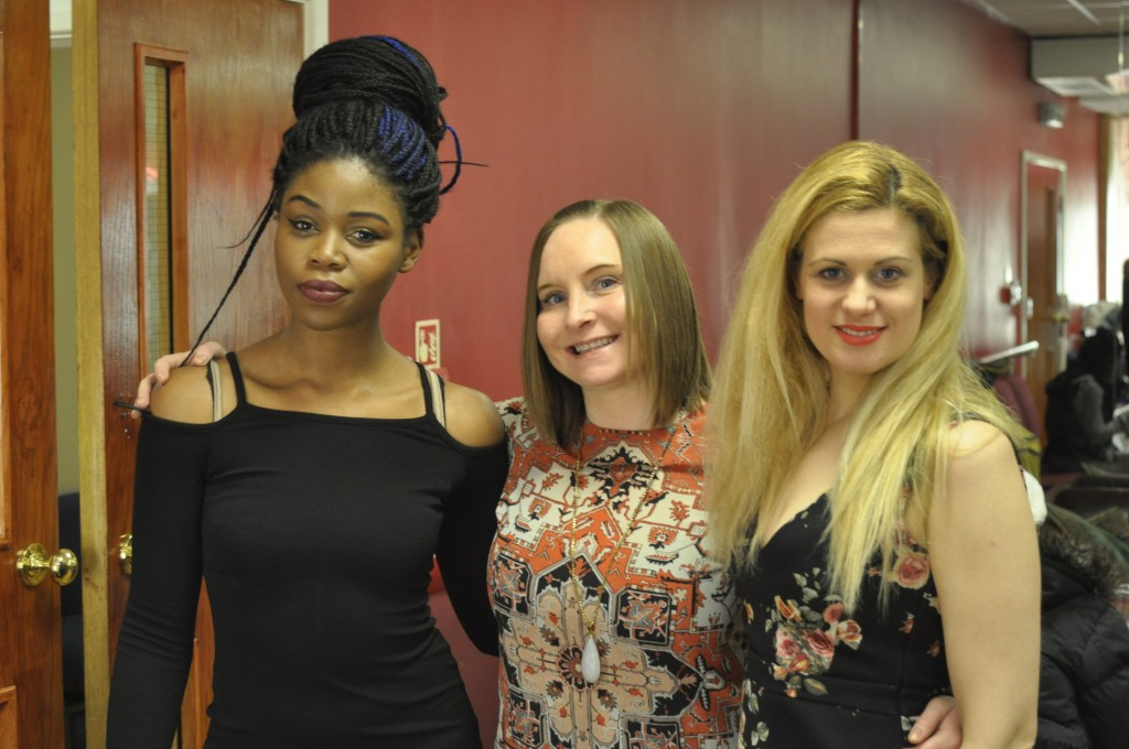 Above: Encore Films Choir members (1st and 3rd from left) JOYCE AGBONSON and LAIA MARTINEZ RUBIR with choir vocal coach, organist and production assistant NATALIE ANNE OWEN
